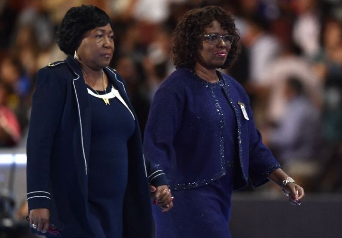 Felicia Sanders (R) and Polly Sheppard (L), two of the three survivors of the Mother Emanuel Church shooting in Charleston, walk off the stage on the third evening session of the Democratic National Convention in Philadelphia July 27, 2016